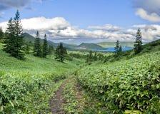 Lake in caldera vulcan Golovnina. Royalty Free Stock Image
