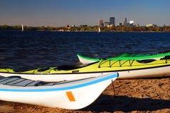 Lake Calhoun Minneapolis. Kayaks Await on Lake Calhoun with the Minneapolis Skyline stock photography