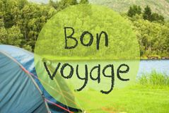Lake Camping, Bon Voyage Means Good Trip. French Text Bon Voyage Means Good Trip. Camping Holiday In Norway At Lake Or River. Green Grass And Forest In Stock Photography