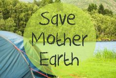 Lake Camping, Text Save Mother Earth, Norway. English Text Save Mother Earth. Camping Holiday In Norway At Lake Or River. Green Grass And Forest In Background royalty free stock photo