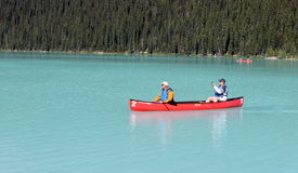Canoe on Lake Louise, Alberta, Canada Stock Photos