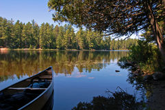 Lake and canoe. After portage in sunny pine forest in Algonquin Park Royalty Free Stock Images