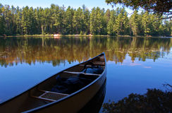 Lake and canoe royalty free stock photo