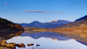 Lake At Capel Curig With Snowdon Behind. The beautiful lake at Capel Curig, North Wales, UK with a snow-capped Snowdon rising behind Stock Photo