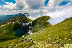 Lake Capra view from Saua Vaiuga. Beautiful summer landscape of Fagarasan mountains, Romania Royalty Free Stock Photo