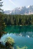 Lake Carezza in Trentino. Rosengarten reflection on Lake Carezza in Trentino Royalty Free Stock Photography