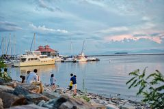 Lake Champlain in Burlington Virginia. Near the waterfront in Burlington Virginia. The sun is setting and the reflection off the water of the sky casts a cool stock photos