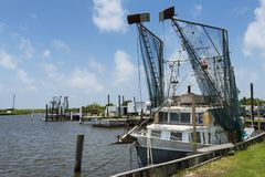 Old shrimp trawler in a port in the banks of Lake Charles in the State of Louisiana. Lake Charles, Louisiana- June 15, 2014: Old shrimp trawler in a port in the Royalty Free Stock Photography