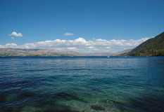 Lake Chelan. View of  Lake Chelan surrounded by hills on a sunny day Stock Photos