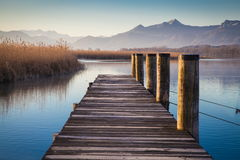 Lake Chiemsee in morning light. Early morning at a jetty at lake Chiemsee Stock Photo