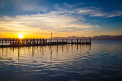 Lake Chiemsee in morning light. Early morning at a jetty at lake Chiemsee Stock Photography