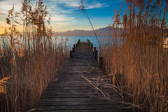 Lake Chiemsee in morning light. Early morning at a jetty at lake Chiemsee Royalty Free Stock Photos