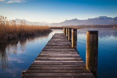 Lake Chiemsee in morning light. Early morning at a jetty at lake Chiemsee Stock Image