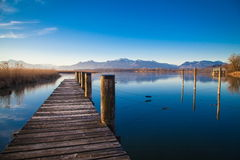 Lake Chiemsee in morning light. Early morning at a jetty at lake Chiemsee Royalty Free Stock Photography
