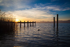 Lake Chiemsee in morning light. A jetty at lake Chiemsee in Bavaria in the morning light Stock Images