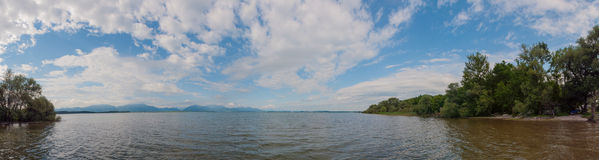 Lake Chiemsee in summer. Bavaria, Germany. Panorama. Lake Chiemsee with Alps in summer. Bavaria, Germany. Panorama Royalty Free Stock Images