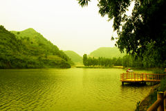 Lake in china. China scenery mountain water and bridge is and have artistic conception royalty free stock photo