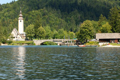 Lake with a church and bridge infront Royalty Free Stock Image