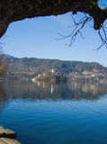 Lake with church on island Stock Photography