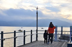 Lake Chuzenji - Japan. Father, son and daughter gaze at the boats in Lake Chuzenjiko Stock Images