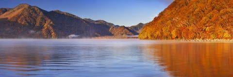 Lake Chuzenji, Japan at sunrise in autumn Stock Image