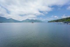 Lake Chuzenji with tourist boat near Nikko, Japan. Wide view of Lake Chuzenji with tourist boat in Nikko, Japan Royalty Free Stock Photos