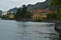 The lake and the city of Como. Of the lake front view towards the city, of the path of Villa Olmo, Como Lombardy Italy, May 2014 Stock Photo