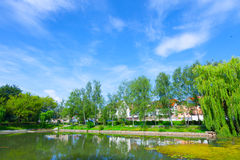 Lake in the city and houses  the horizon Royalty Free Stock Image