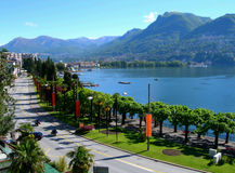 Lake and city of Lugano. View of Lake and city of Lugano promenade, in Switzerland Alps royalty free stock photos