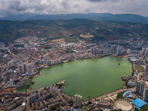 A lake in the city. A whole view of the lake rounded by the city royalty free stock photography