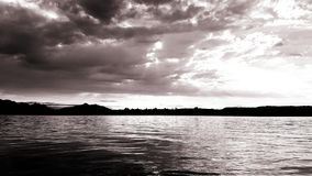 Lake and the claude's. Claudes, water, besh, black, white, larger, big, deep, sunny, nature, power, success royalty free stock image