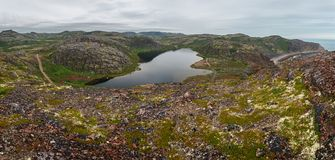 Lake with clean, fresh water on the shore of the Barents sea. Kola Peninsula , Russia stock photography