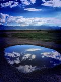 Lake Cloud. Reflection lake puddle gorgeous clouds sky white silver blue Stock Images
