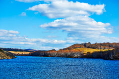 The lake and cloudscape on autumn steppe Stock Images