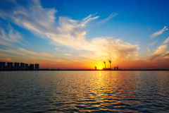 The lake and cloudscape sunset Stock Image