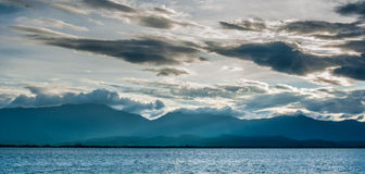Lake with cloudy sky and sun beam Royalty Free Stock Photos