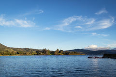 Lake in Colombia. Landscape taken from La Cocha lake with deep blue waters and mountains on the background, on a sunny day Royalty Free Stock Photography