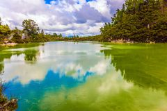 Lake with colorful opaque water. The magic country is Wai - O - Tapu. New Zealand, North Island. The concept of active and phototourism royalty free stock photo