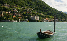 Lake Como. A boat near the town of Domaso on the northweswtern shore of Lake Como, Italy royalty free stock photo