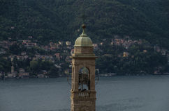 Lake Como 2. Church steeple foreground with Lake Como and housing in background Stock Image