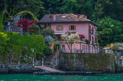 Lake Como 9. Lake Como has beautiful housing and estates surrounded by lush forrest and mountains Stock Photo