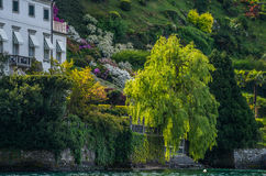 Lake Como 17. Lake Como has beautiful housing and estates surrounded by lush forrest and mountains Stock Images