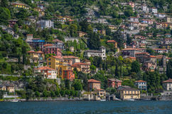 Lake Como 34. Lake Como has beautiful housing and estates surrounded by lush forrest and mountains Royalty Free Stock Images