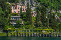 Lake Como 35. Lake Como has beautiful housing and estates surrounded by lush forrest and mountains Stock Images