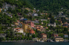 Lake Como 31. Lake Como has beautiful housing and estates surrounded by lush forrest and mountains Stock Photo