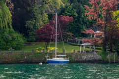 Lake Como 16. Lake Como in Italy beautiful scenery surrounded by snow capped mountains and lush Forrest Stock Images