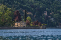 Lake Como 25. Lake Como in Italy beautiful scenery surrounded by snow capped mountains and lush Forrest Stock Photo