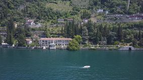 LAKE COMO, ITALY from the drone and the Italian Alps in background. LAKE COMO, ITALY Villa Desta from the drone and the Italian Alps in background 4K stock video