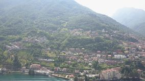 LAKE COMO, ITALY from the drone and the Italian Alps in background. LAKE COMO, ITALY Villa Desta from the drone and the Italian Alps in background 4K stock footage