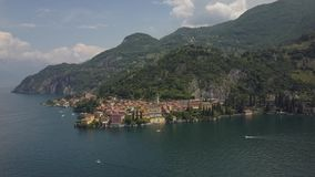 LAKE COMO, ITALY from the drone and the Italian Alps in background. LAKE COMO, ITALY Villa Desta from the drone and the Italian Alps in background 4K stock video footage